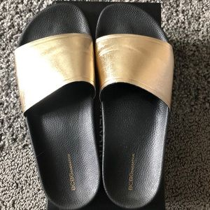 BCBGeneration Cyabee-X Black and Gold Slides